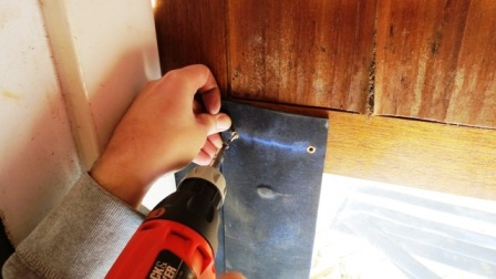 Use the cordless drill to attach the strips to the door.