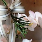 Bow and orchids