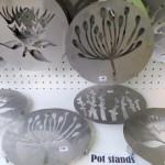 Potstands from Black Sunbird