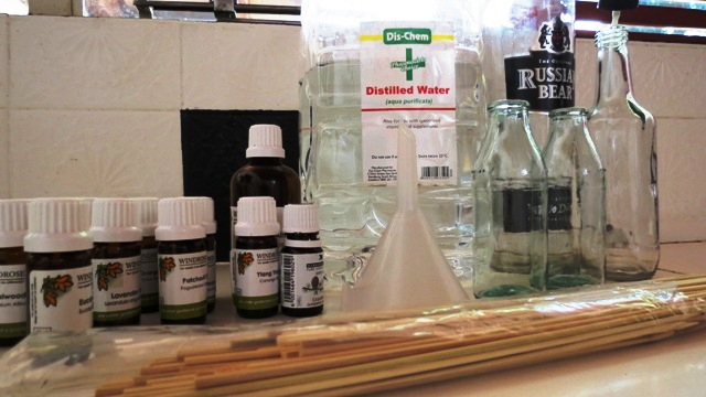Distilled water, vodka, funnel, essential oils and bamboo skewers